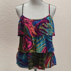 """Beautiful Trina Turk 3 tiered blouse Brand: Trina Turk • Type: Sleeveless (spaghetti strap), layered blouse. Abstract, multicolored pattern • Size: Medium • Fabric: Silk, cotton and spandex blend • Condition: Excellent used condition • Color: shades of blue, green, pink, purple, mustard yellow • Measurements: Bust - 17.25"""" across the front, lying flat. Length - 25"""" from shoulder to bottom hem. Trina Turk Tops Blouses"""