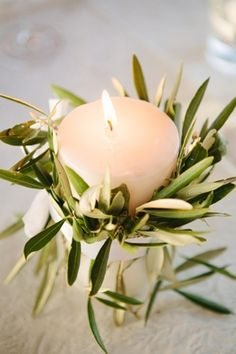 Candle with olive leaf decoration wedding decor | SouthBound Bride | http://www.southboundbride.com/olive-navy-tokara-wedding-by-aglow-photography-tamsyn-gerrit | Credit: Aglow Photography