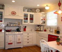 L shaped vintage white kitchen with red accents
