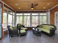 Love this three season room with wood paneled walls so for 3 season porch furniture