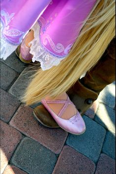 Flynn teaching Rapunzel how to dance! This picture is so cute I can't even handle it!