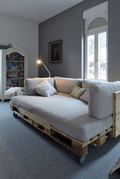 Pallet couch with wheels so it's easy to move