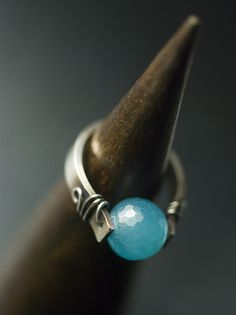 "https://flic.kr/p/a3utPa | Aqua Blue Jade Sterling Silver Metalwork Ring by Moss & Mist Jewelry | A huge glowing translucent faceted Aqua Blue Jade bead is the heart of this elegant ring, wrapped with sterling silver wire onto a sleek oxidized handcrafted metalwork sterling silver ring frame.  My Etsy shop: <a href=""http://www.mossandmist.etsy.com"" rel=""nofollow"">www.mossandmist.etsy.com</a>"