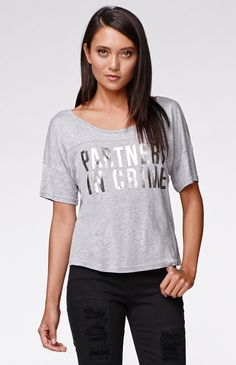 """The women'sPartners Football T-Shirt by Kendall & Kylie for PacSun and PacSun.com features a cropped cut and metallic graphic on the front. We love the super soft fabric and and slouchy fit. Wear this tee with our high waisted denim and layer with a cardigan!18"""" length3"""" sleeve lengthMeasured from a size smallModel is wearing a smallHer measurements: Height: 5'9"""" Bust: 32"""" Waist: 25"""" Hips: 35""""100% rayonMachine washableImported"""