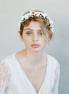 A full floral halo bursting with hand made clay flowers, rhinestone encrusted and brass leaves by Twigs and Honey