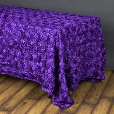 """90""""x156"""" Purple Wholesale Grandiose Rosette 3D Satin Rectangle Tablecloth For Wedding Party Event Decoration /  Add oodles of flair and character in your party with our enticing raised rosette tablecloth, which is simply breathtaking. The very sight of this floral ecstasy will bring the divine vision of a paradise garden with its whimsical blossoms and luster into your event/celebration. For those special and rare celebrations that need to have an extra doting touch in their ambiance…"""