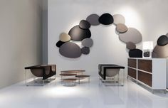 Complete lobby with STUA line: Nube armchairs, Eclipse nesting tables, Satellite acoustic panels, Sapporo storage system.