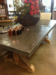 Rustic metal wrapped wood dining table made by Rustic Rooster