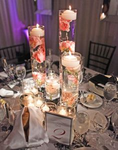 Kristi- floating candle centerpiece. 3 cylinders, 3 different heights, different flowers in each, curly willow spiraled inside too? :)