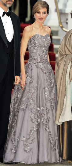 Letizia wears an elegant gray Felipe Varela evening gown to a pre-wedding dinner for Prince William and Kate Middleton at the Mandarin Oriental Hyde Park in London.