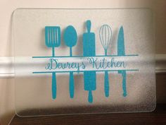 Personalized cutting board with kitchen gadgets.