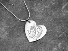 Our double print pendant doesn't have to have prints from one child, you can have siblings on it too http://silverhavenjewellery.com/products/224147--double-print-pendant.aspx