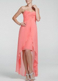 Very chic and right on trend, this high low bridesmaids dress calls for command!  Strapless bodice with sweetheart neckline features ruched bust.  High low dress with split front detail and sheer hem gives this dress layers of unique appeal.  Fully lined. Back zip. Imported polyester. Dry clean only.  To protect your dress, try our Non Woven Garment Bag.