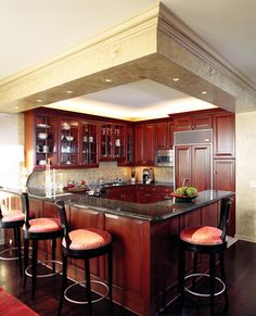 Lake Shore Drive Condo Kitchen::Deb Reinhart Interior Design Group:: corner bar, black and red barstools, granite