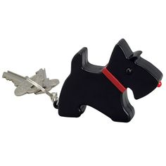 """Barking Scottie Dog Key Ring, Item #47974, $12.99.  Never lose your keys again with the Barking Scottie Key finder. Just clap your hands three times and Scottie will start barking to alert you to where he has been guarding your keys. He also features an LED flashlight nose to help you find your lock on a dark evening. Small enough to fit in your pocket, this loyal canine clips onto your keychain so you can take him with you wherever you go. 3 """"AG13"""" batteries included."""