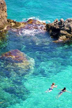 Swimming in crystal clear water off the coast of #Greece.