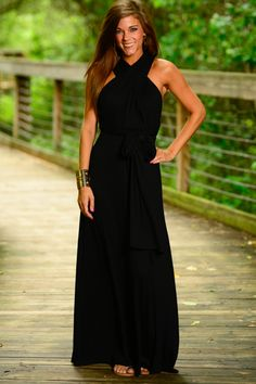 This black maxi dress is a jaw dropper! We are in love with the back of this dress and it's easy to see why! You can wrap and tie it any way you like! Perfect for any event you are going to this summer!