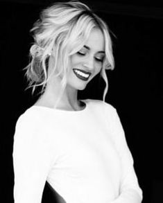 Messy light blonde updo with waves & bright red lips