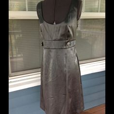 "NWTCONNECTED APPAREL Gun Metal Gray Dress NWTCONNECTED APPAREL shiny gray dress.  Sleeveless.  Scooped neckline.  Fully lined.  Decorative button adorned waist, 31"". Side zipper.  Length 37"" (shoulder to hem). Connected Apparel Dresses"