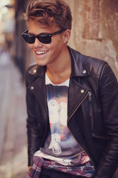 leather jacket, graphic tee, and ray bans