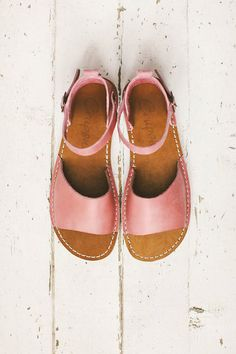 These pink pastel leather sandals are lovely. They look like they would easily fit with most outfits too!
