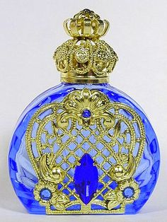 Mouth-blown glass perfume bottle handmade in the Czech Republic by a 200-year-old family-run business. With handmade wiring & hand-placed stones.