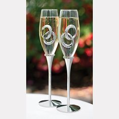 Two Rings - Flutes These glass wedding toasting flutes sparkle and shine with a design of nickel-plated double rings and rhinestone accents.