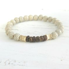 Natural Lotus Seed Bead Bracelet with Coconut Heishi and 14K Gold #organic #jewelry #yoga