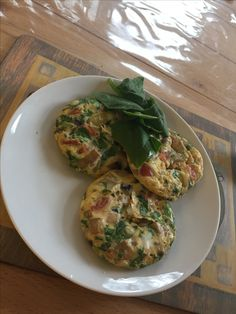Egg, spinach, tomato, onion and mushroom omelette bites served with spinach leaves and avocado