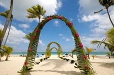 Google Image Result for http://www.wedding-reception-decoration-ideas.com/image-files/hawaiian-wedding-arch.jpg