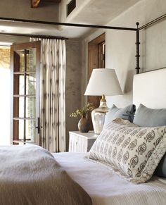 Gorgeous tonal bedroom from Wiseman and Gale. I love the combination of the textured wall finish, warm dark wood and powder-colored linens.