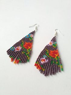 Simple and beautiful hand beaded earrings. Earrings are made of czech beads. Item will be shipped in 1-3 days after the purchace with Registered Priority Mail Worldwide. ----------------- Custom orders are welcome - other colors, forms, patterns etc. Feel free to contact me