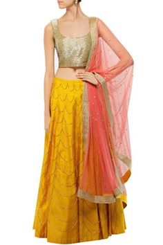 Featuring a mustard yellow paneled silk lehenga with gold scallop pattern hanging cutdana work increasing in size towards the hem. Shop Now at www.carmaonlineshop.com #carma #carmaonlineshop #shopnow #indian #fashion #designer #couure #pretty #sheek #classy #beauty #love #smile #ootn #oneshoulder #nude #gown #gold #glitter #drape