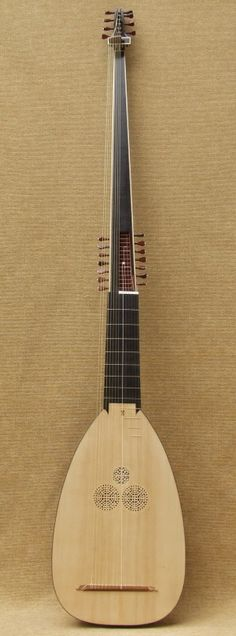 The theorbo is a plucked instrument developed for the purpose of playing along opera music. The for the shocking lengt of the instrument, and the second peg-box, is simply the need for open-fretted bass-strings (called diapasons or bourdons). The most prominent composers of theorbo-music were Kapsberger and Piccinini.