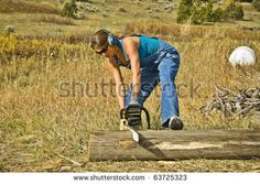 A young woman operating a chainsaw