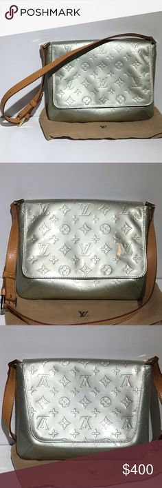 Authentic Louis Vuitton Handbag Pre-owned Authentic Louis Vuitton Shoulder bag. Silver with tan leather. The bag does have a few spots on the outside of the bag, you can see a close-up of them on the last picture. Dust bag included. Louis Vuitton Bags Shoulder Bags