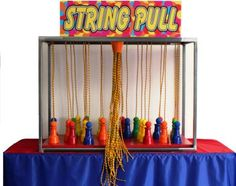 string pull carnival game - frame could be interlocking pvc pipe for easy dismantle/storing.  Top would be peg board to lace the strings through.  Cones could be colorful dollar store cups.  Place prizes under cups.  They pull a string and the rising cup reveals the prize.