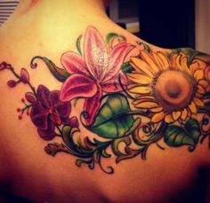 sunflower/lily/orchid I like this but i would replace the lily with a rose for my mother.