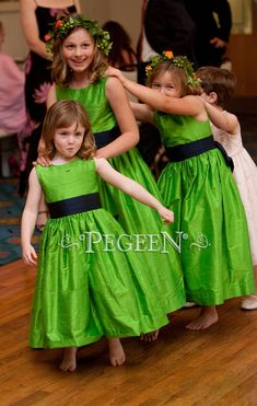 Flower girl dresses in keylime green and navy midnight by Pegeen.com