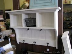 """Entry shelf - Built with 5/8"""" solid bead board & pine boards.  Painted with latex paint, distressed and glazed to give an antique look.  Cupboard is  19""""w x 49""""h x 15 1/2""""D, top overhangs 1 1/2"""" in front and each side. Blue Roof Cabin"""