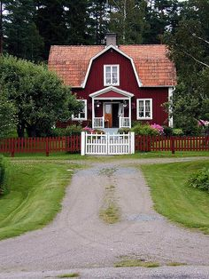 Can I move in tomorrow? Please!!  So inviting.  Dream house, Dutch Colonial, small front porch, red with white trim, lovely drive, landscaping, fence.