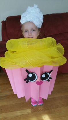 Shopkins Cupcake Costume Assembly: Whipped cream- 2 white jumbo size pipe cleaner hot glued to headband. Yellow icing- sparkle tulle. Cupcake- 2 pieces of pink poster board folded & hot glued to white foam wreath. Shopkins face- various colored felt pieces hot glued & taped together.
