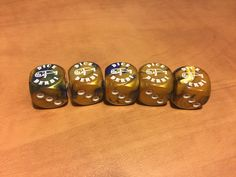 Gemini Blue and Gold with White pips. $14.99  Makes a great addition to the game or even a souvenir.