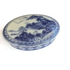 Vintage hand painted Chinese porcelain box with lid. In nice condition with no chips or cracks. There are some natural imperfections in the glaze on some of the mountains (see closeup photo). Measures long x wide x high Porcelain, White Porcelain, Chinese Porcelain, Blue, Trinket Boxes, Box With Lid, Blue And White, Trinket, Hamptons Style Decor