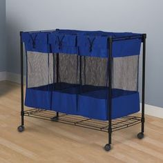 "Castered storage bin with three removable mesh bags.Product: Laundry sorterConstruction Material: ClothColor: BlueFeatures: Heavy-duty construction with three extra sturdy removable bagsMesh center band allows view of bags' contentsEasy glide casters for mobilityWire frame bottom enhances stability and keeps bags off floorDimensions: 32.5"" H x 35.37"" W x 17.75"" DNote: Assembly required"