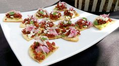 Tostaditas de Chorizo: grilled chorizo served on fresh guacamole and house-made tortilla chips.  More info: http://www.sohotaco.com/2014/04/18/tantalizing-appetizers-for-a-terrific-laguna-beach-birthday  #tacocatering #tacocartcatering #lagunabeach #orangecounty