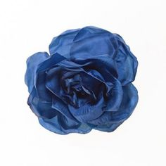 A beautiful blue rose that can be worn as a hair band, a corsage or to pin on your clothes. Great for weddings, holidays, proms and evenings out.