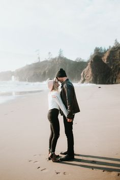These stylish engagement photos feature a gorgeous West Coast beach and four outfits in a fabulously neutral color palette.