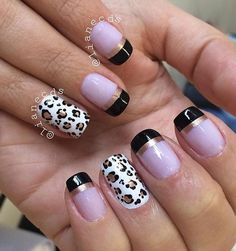 Black and white leopard nail art design with French tips. A simple and cool looking design perfect for your nails. The black French tips also help give an edge to your nails.