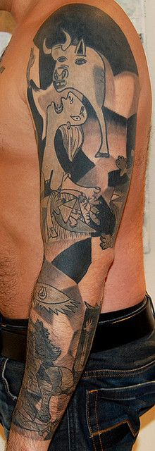 picasso's guernica in sleeve form     Very unusual and very cool tattoo sleeve... www.thetattoofanatic.com